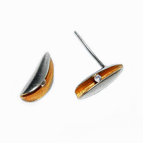 Side diamond shell stud earrings 2pt (0.02ct) vsfg diamond in a rich 22ct gold plated interior. Approx max dimensions are height 14mm, width 6mm, depth 6mm. The earrings usually come in a satin finish.