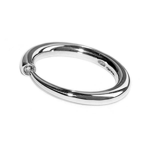 Simple elegant silver ring with comfortable rounded band set with a brilliant 3pt (0.03ct) vsfg diamond. Dimensions: solid 3mm band tapering to a point. The ring is unusual and elegant and therefore makes the perfect engagement ring. In addition there is a matching wedding ring code c19A.