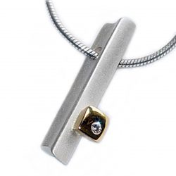Silver 18ct diamond ingot The solid silver pendant has contrasting chunky 18ct yellow gold detail set with solitary sparkling diamond.