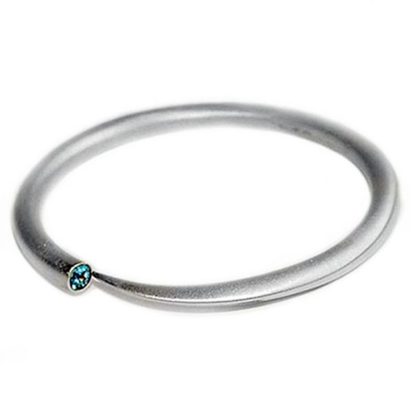 The classic tapering wiggly bangle is one of the original pieces in the collection. It is comfortable and perfectly weighted because it has a solid silver 6mm round band which tapers to a point. The bangle comes with a variety of semi precious gemstones and is featured with blue topaz. A beauiful and pure design. It therefore remains one of the popular favourites in the collection.