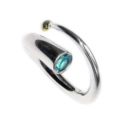 The silver spiral wiggly ring wraps comfortably around the finger. The solid silver ring tapers from 6mm to a point enriched with 18ct gold detail. The ring features a sparkling 5mm blue topaz.  Other gemstones are available for example amethyst, iolite, peridot, citrine, garnet.