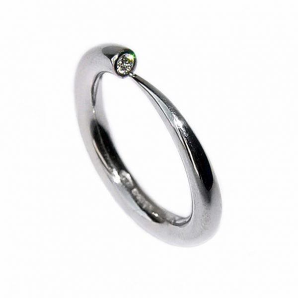 Simple elegant 18ct white gold ring with comfortable rounded band set with a brilliant 0.03ct diamond vsfg quality. The ring tapers from 3mm. (also available in 9ct & 18ct yellow gold, 9ct white gold and platinum - prices on request). This beautiful handcrafted ring is a perfect engagement ring.(in addition there is a 4mm version with 0.1ct diamond C18GW)