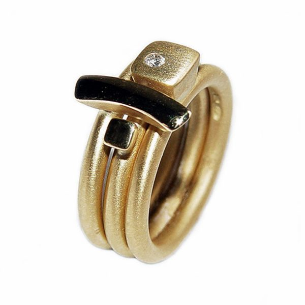 The 18ct gold square diamond ringset consists of 3 unique rings. Each solid gold ring has 18ct gold detail with contrasting finish & one comes with with a sparkling diamond (0.02ct vsfg). Each ring is 2.5mm wide and has a comfortable rounded band (maximum width of the ring set is 7.5mm). Please contact us if you would like to buy the rings individually.