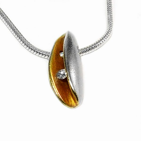 Small silver diamond pendant with 2pt (0.02ct vsfg) diamond and rich 22ct gold plated interior. It is 14mm in height, 4mm in width and 6mm in depth. The pendant usually comes in a satin finish on a silver snake chain.