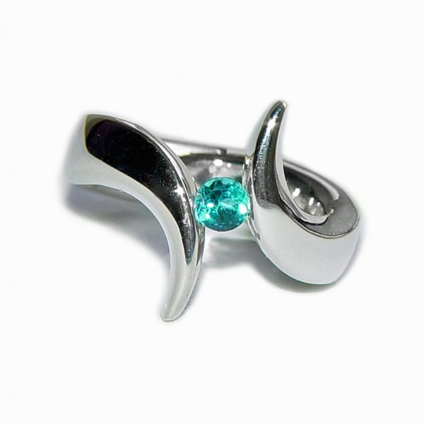 The tension set 5mm double point ring is elegant & eye catching. The solid silver ring is hand forged from 5mm wire & is set with a 5mm blue topaz. The silver tension ring is handmade to order and It comes in a wide range of sizes (including 1/2 sizes). We have used the UK/AU sizing system If you have a ring size based on EU, US/Canada or any other international sizing system we can convert it. The 5mm double point ring comes in a satin or highly polished finish.