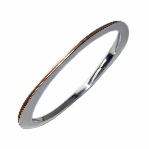 An unusual solid silver bangle. The bangle is split all the way round & has a contrasting rich 22ct gold plated interior. It is perfectly weighted with approximated maximum dimensions of width 3.5mm, and height of 5.5mm  to 9.5mm at the widest point.