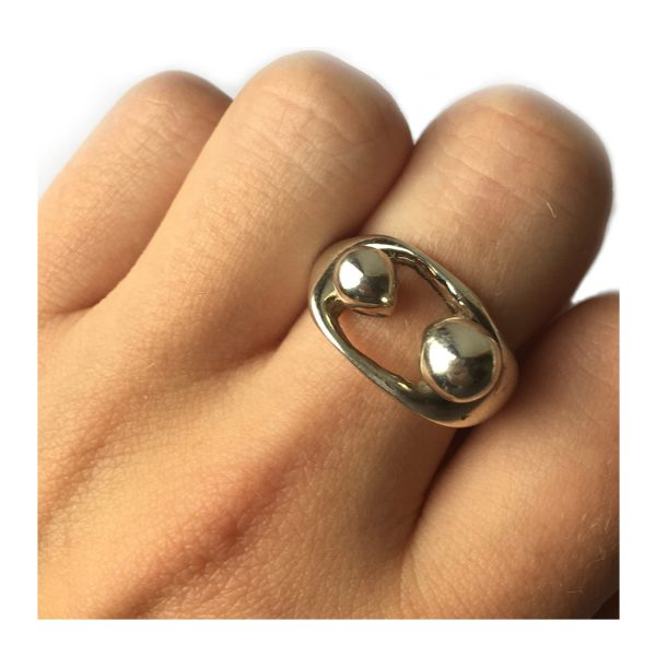 The ''Mother & Child'' sculptural silver ring is comfortable & tactile. It has a flat scultured band with a depth of approx 2mm and a width of 8mm at the widest point across the back.
