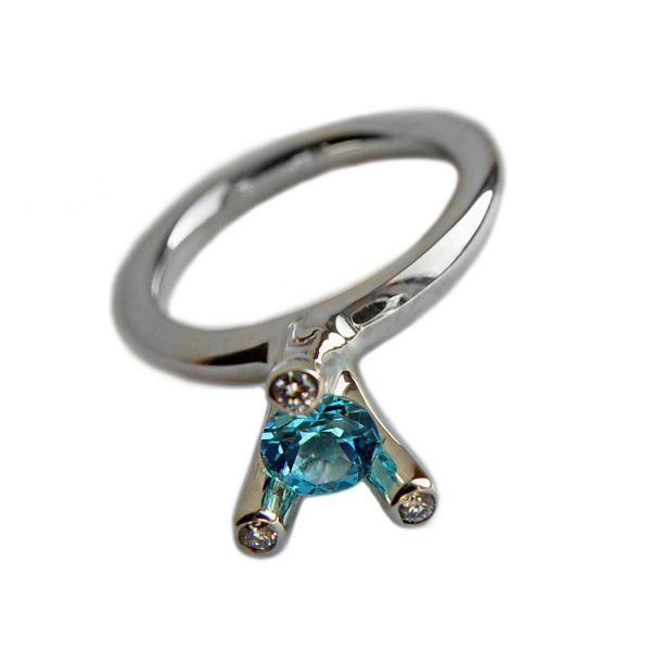 The 3 branch bough ring is bold and majestic in design and is inspired by nature. The silver ring has a comfortable rounded shank of 3mm and the setting consists of a 5mm gemstone encircled by 3x 0.02ct diamonds (height of setting when worn is approx 8mm). The featured image shows a 5mm blue topaz. The ring comes with a variety of gemstones for example amethyst, iolite, citrine, peridot & garnet.