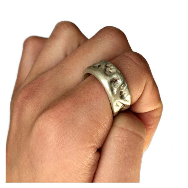 This chunky silver band has an unusual hammered design. This ring is tactile & very comfortable to wear and has approximate maximum dimensions of width 10mm & depth 3mm.