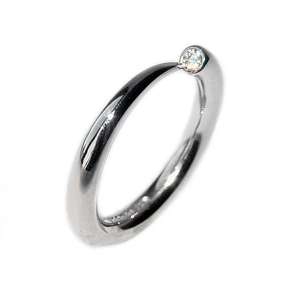 Simple elegant platinum narrow wiggly ring with comfortable rounded band set with a brilliant 0.03ct diamond vsfg quality. The ring tapers from 3mm. (also available in 9ct & 18ct yellowgold, 9ct white gold prices on request). This beautiful handcrafted ring is a perfect engagement ring.(In addition there is a 4mm version with 0.1ct diamond C18P).