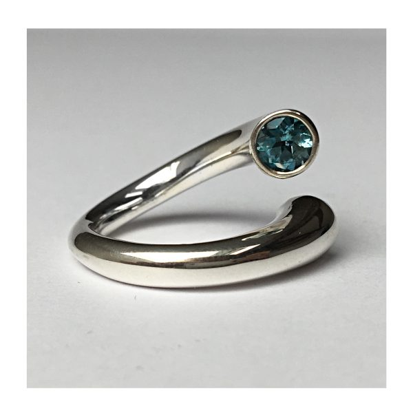 The double taper wiggly ring featured has 2x 5mm blue topaz. The solid silver ring tapers from 6mm and the middle section of the band is 3mm. The ring is comfortable, perfectly balanced therefore ideal for everyday wear.