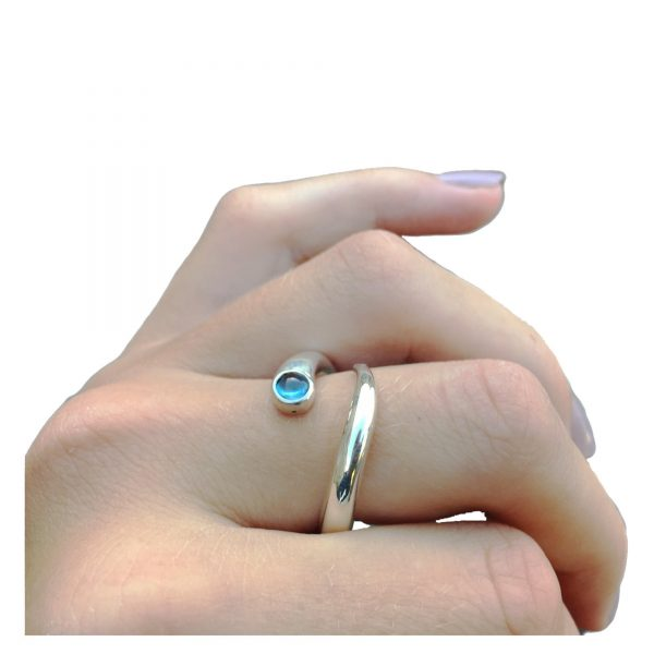 Curving silver wiggly ring with 3mm collet set cabochon gemstone. The unique handcrafted ring is practical and ideal for everyday wear because it has a comfortable rounded 4mm band.