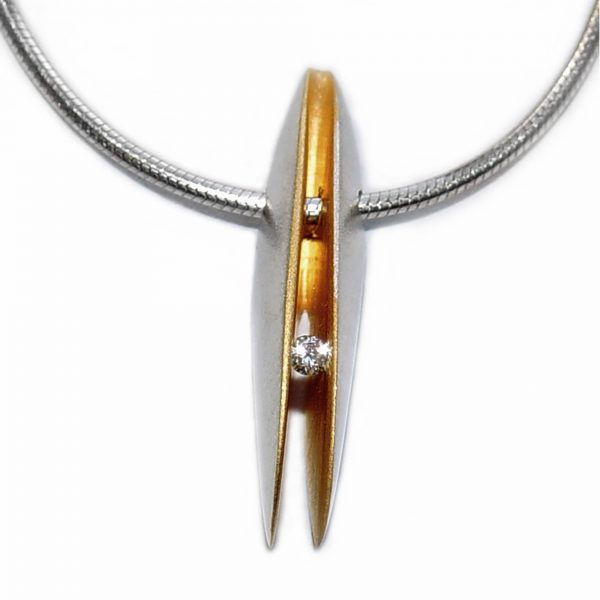 Solid front silver shell pendant with 3pt (0.03ct vsfg) diamond set within a rich 22ct gold plated interior. It is 24mm in height with a width of 4mm and depth of 6mm. The pendant usually comes in a satin finish on a silver snake chain.