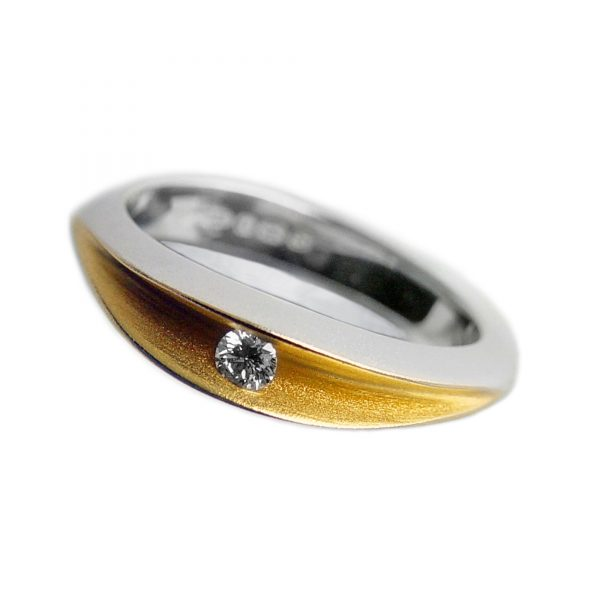 The 10pt partially split ring is an elegant unusual silver diamond ring. A sparkling diamond (0.1ct vsfg) is trapped within the rich 22ct gold plated interior. The ring is split across the top and has a solid band across the back. Approximate maximum dimensions are 5mm width & 5mm depth. 18ct white gold and 18ct yellow gold versions are also available. Please contact for further details
