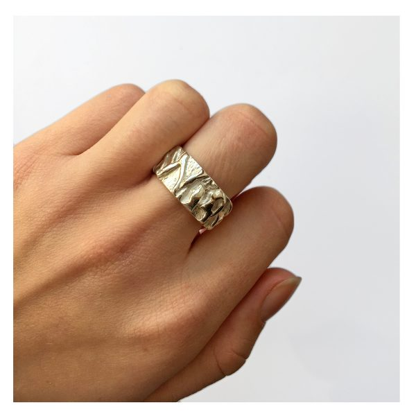 This textured silver vine band has an unusual intricate pattern with a smooth polished interior. The ring is approximately 10mm wide with a depth of 2.5mm.