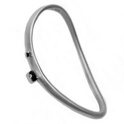 This striking silver diamond bangle has silver detail and is set with a single sparkling diamond (0.02ct vsfg). The solid silver bangle is hand forged from round wire which creates its unusual & unique shape. it is approx 4mm wide at the top.  Each bangle is individually handmade to order and can be made in a range of sizes. It comes in an all satin finish, or in a satin finish with polished silver detail (as featured).