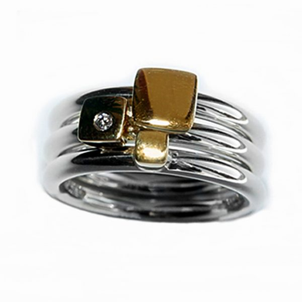The 18ct square diamond ringset consists of three individual rings. Each silver ring is 2.5mm round with a comfortable rounded shank (maximum width of ring set is 7.5mm). Each silver ring has contrasting 18ct yellow gold detail and one ring is set with a single diamond (0.02vsfg). The ring set is also available with silver detail, or in a solid 18ct yellow gold version. The rings can also be bought individually on request.