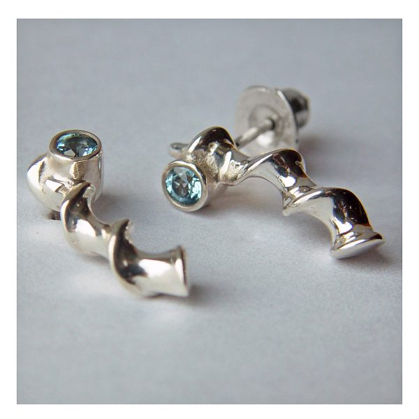 These silver vine drop studs are unusual & stylish and are set with sparkling 3mm gemstones. The earrings are approx 18mm long with a width of approx 4.5-5.5mm & are available in polished or satin finished sterling silver. The main image shows the earrings with a blue topaz gemstone. You can also choose from amethyst, iolite, peridot, garnet, citrine, cubic zirconia. The silver vine drop studs come in a Paul Finch jewellery gift box. Cleaning instructions For satin finish use silver dip, rinse in warm soapy water, dry thoroughly. For polished finish use silver polishing cloth/ and or silver dip. FREE Delivery The parcel will be sent out using secure Colissimo International tracked and signed for service and will require a signature on receipt. Dispatched within 2-5 working days.