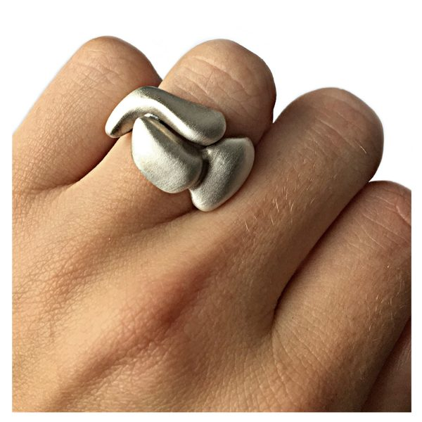 The solid sculptural silver band is smooth, tactile and perfectly weighted. It has a width of 7mm, depth of 2mm and is approx 13mm at the widest point across the top. The ring is individually handmade to order and comes in a wide range of sizes including 1/2 sizes.  Please let us know your ring size when you place your order. We use the UK/AU sizing system, however. If you have a ring size based on EU, US/Canada or any other international sizing system we can convert it. If you would like the ring in 9ct or 18ct gold please contuct us for more details. The sculptural silver band has a Paul Finch hallmark and conforms to the British hallmarking standard. It comes in a branded jewellery box. Cleaning instructions   For satin finish use silver dip, rinse in warm soapy water, dry thoroughly. For polished finish use silver polishing cloth/ and or silver dip. FREE Delivery The parcel will be sent out using secure Colissimo International tracked and signed for service and  requires a signature on receipt. Dispatched within 2-5 working days