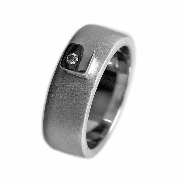 Silver diamond ring HRW1AD. This solid silver ring has silver detail and a sparkling 0.02ct vsfg diamond. The band is 7mm wide and has a depth of approx 2mm. The ring is practical and comfortable to wear.(See also silver/18ct version HRW1AG) Silver Diamond ring HRW1AD is individually handmade to order and comes in a wide range of sizes including 1/2 sizes. Please let us know your ring size when you place your order.We use the UK/AU sizing system, however. If you have a ring size based on EU, US/Canada or any other international sizing system we can convert it. The ring has a Paul Finch hallmark and conforms to the British hallmarking standard. It comes in a Paul Finch jewellery gift box. Cleaning instructions For satin finish use silver dip, rinse in warm soapy water, dry thoroughly. For polished finish use silver polishing cloth/ and or silver dip. FREE Delivery The parcel will be sent out using secure Colissimo International tracked and signed for service and requires a signature on receipt. Despatched within 2-5 working days