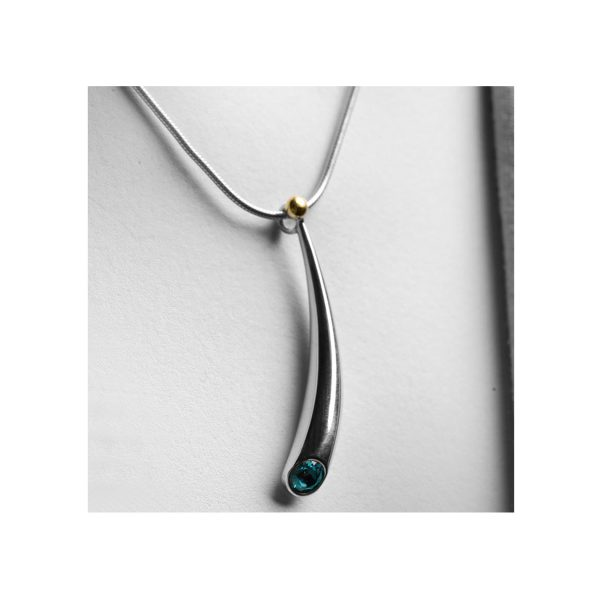An elegant short curved wiggly pendant with 5mm blue topaz & 18ct gold bead on a silver snake chain. The pendant tapers from 6mm & is approx 38mm long. A beautiful & pure design