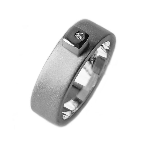 Silver diamond ring HRW1AD. This solid silver ring has silver detail and a sparkling 0.02ct vsfg diamond. The band is 7mm wide and has a depth of approx 2mm. The ring is practical and comfortable to wear.(See also silver/18ct version HRW1AG)