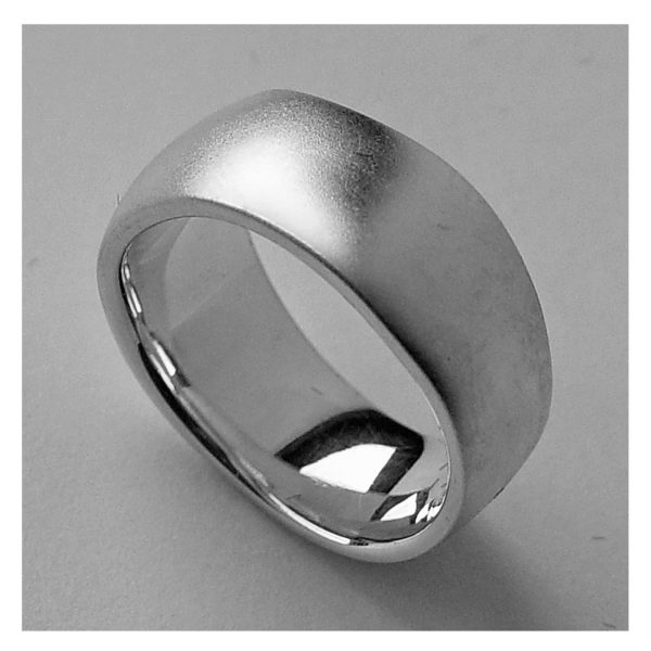 An unusual organic silver band. The smooth solid undulating band is approx 11mm at the widest point and has a varying depth of 2-3mm. It is practical and comfortable to wear. The ring is individually handmade to order and is available in a wide range of sizes including 1/2 sizes. Please let us know your ring size when you place your order. We use the UK/AU sizing system, however. If you have a ring size based on EU, US/Canada or any other international sizing system we can convert it. If you would like the ring in 18ct gold, please contact us for more details. The organic silver band has a Paul Finch hallmark and conforms to the British hallmarking standard. It comes in a branded jewellery box.