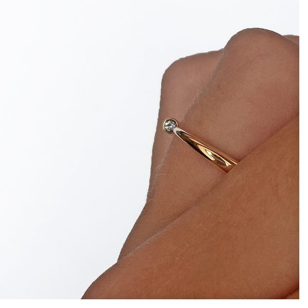 The 9ct narrow wiggly ring has a comfortable rounded band which tapers to a point from 3mm and is end set with a brilliant 0.03ct vsfg diamond. It is a beautiful pure design.