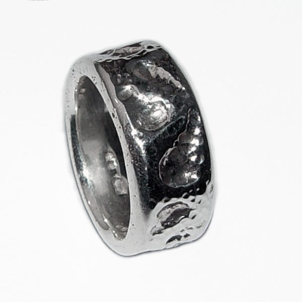 This chunky silver band has an unusual hammered design. This ring is tactile & very comfortable to wear and has approximate maximum dimensions of width 10mm & depth 3mm
